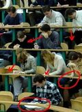 Students-cheating-on-exam-219x300